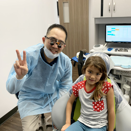 A child after receiving family dentistry in Richmond, TX